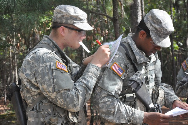 Soldiers practice their land navigation skills in the field.