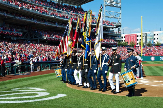 A joint service honor guard participate in the opening ceremony for the Nationals vs Cardinals game at Nationals Stadium in Washington, D.C., Oct. 10, 2012. This is the first major league postseason game in Washington since the 1933 World Series with the Washington Senators. Wounded Warriors and active duty military service members were honored during the game with a standing ovation by fans.