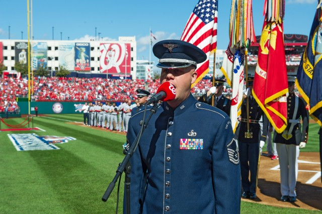 Air Force Master Sgt. Ryan Carson sings the National Anthem during the opening ceremony for the Nationals vs Cardinals game at Nationals Stadium in Washington, D.C., Oct. 10, 2012. This is the first major league postseason game in Washington since the 1933 World Series with the Washington Senators. Wounded Warriors and active duty military service members were honored during the game with a standing ovation by fans.