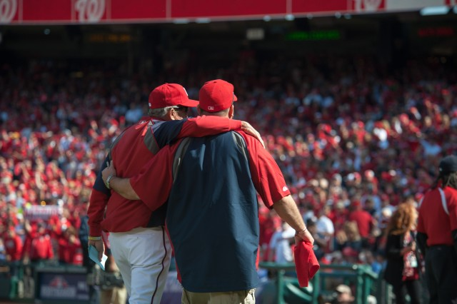 Nationals' manager Davey Johnson hugs former Army Staff Sgt. Brian Keaton Sr., during the Nationals vs Cardinals game at Nationals Stadium in Washington, D.C., Oct. 10, 2012. Keaton is a combat veteran with multiple deployments to Iraq. He suffers from frequent seizures, and that keeps him from traveling much. He is a patient at Walter Reed National Military Medical Center in Bethesda, Md., and baseball, his life-long love, has aided his recovery.