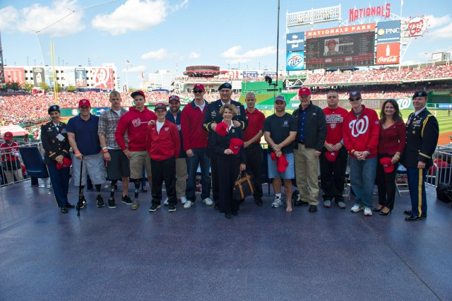 Army Chief of Staff Gen. Raymond T. Odierno and wife Linda pose for a photograph with Wounded Warriors at the Nationals vs Cardinals game at Nationals Stadium in Washington, D.C., Oct. 10, 2012.  Wounded Warriors and active duty military service members were honored during the game with a standing ovation by fans.