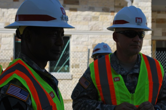 Lt. Gen. Thomas P. Bostick, chief of Engineers, and Col. Charles H. Klinge, Jr., commander, Fort Worth district listen to a briefing outside the Fort Hood Chapel.