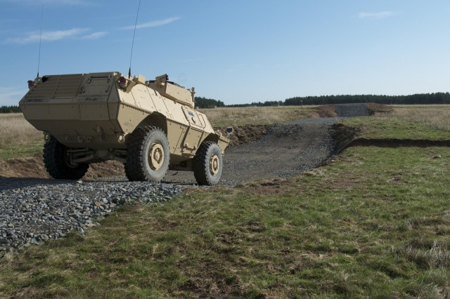 Soldiers of the 615th MP Company navigate an obstacle on the new Driver's Training Complex at the Grafenwoehr Training Area in Germany.