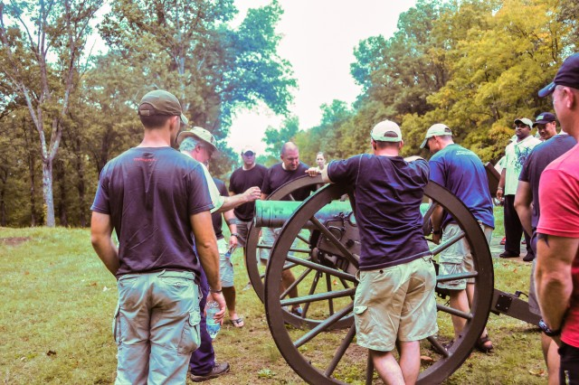 Officers and senior enlisted with 1st Battalion, 502nd Infantry Regiment, 2nd Brigade Combat Team, 101st Airborne Division (Air Assault), gather around a cannon used during the civil war by the confederates defending Fort Donelson, Sept. 28. The cannons were used with other defense techniques to keep the encroaching Union soldiers at bay.