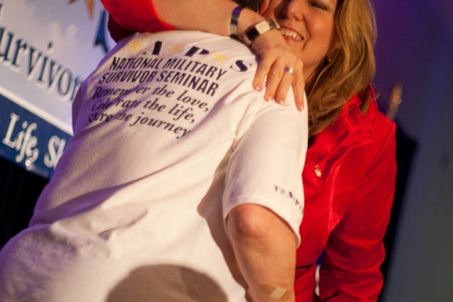 Tragedy Assistance Program for Survivors founder Bonnie Carroll hugs a family member during the TAPS National Military Survivor Seminar and Good Grief Camp in Arlington, Va., held during Memorial Day weekend this year.