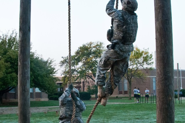 """FORT CAMPBELL, KY """" Strike Soldiers from Headquarters and Headquarters Company, 2nd Brigade Combat Team, 101st Airborne Division (Air Assault), begin their ascend to the top of the Air Assault Rope Climb, Oct. 4 at Fort Campbell's Strike Field during the Strike Brigade's combat focused physical training competition called the Iron Strike Challenge. The challenge is designed to push participants to their physical limits while promoting team and unit cohesion. (U.S. Army photo by Sgt. Mike Monroe, 2nd BCT PAO, 101st Abn. Div.)"""