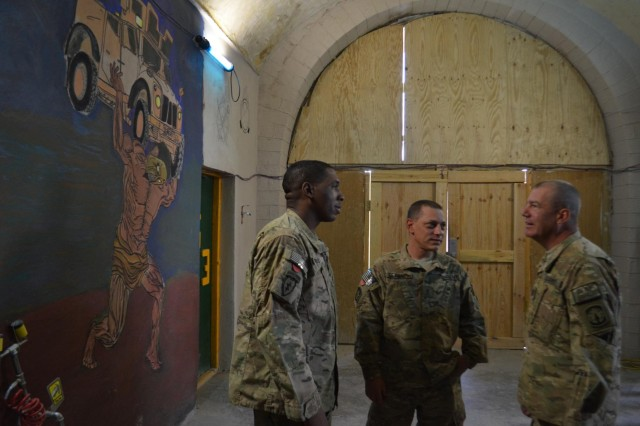 """Capt. Randy Loux, a Mazomanie, Wis., native who serves as the battalion chaplain for Task Force Ripcord, 503d Military Police Battalion (Airborne), which is currently deployed to Kandahar City as part of Combined Task Force Lancer, 2nd Stryker Brigade Combat Team, speaks with soldiers assigned to different bases throughout Kandahar city Oct. 2, 2012. Loux often travels to several bases every month in an effort to have a """"ministry of presence"""" where soldiers know he and his team are there for them. (Photo by Capt. Anouar Bencheqroun, 503d Military Police Battalion (Airborne))"""
