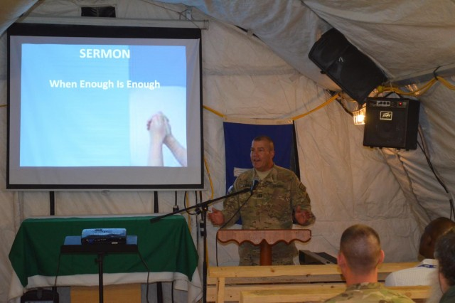 Capt. Randy Loux, a Mazomanie, Wis., native who serves as the battalion chaplain for Task Force Ripcord, 503d Military Police Battalion (Airborne), which is currently deployed to Kandahar city as part of Combined Task Force Lancer, 2nd Stryker Brigade Combat Team, leads a group of soldiers through a sermon held at the Camp Nathan Smith, Afghanistan, chapel. (Photo by Capt. Anouar Bencheqroun, 503d Military Police Battalion (Airborne)).