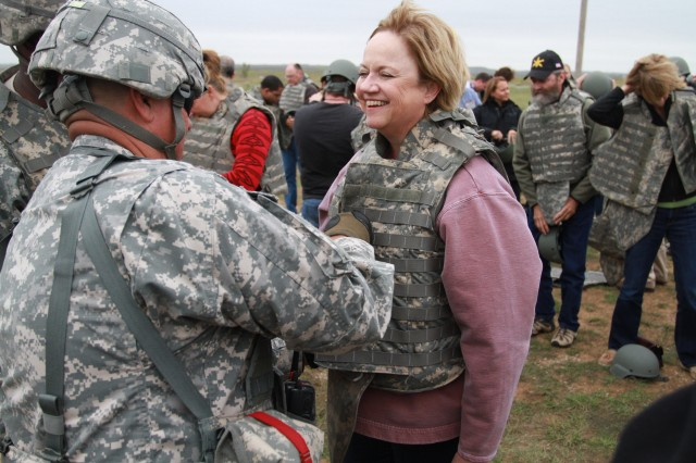 Fifty leaders from across the state gear up to watch M119 A2s fire Oct. 5 as part of their visit to Fort Sill.