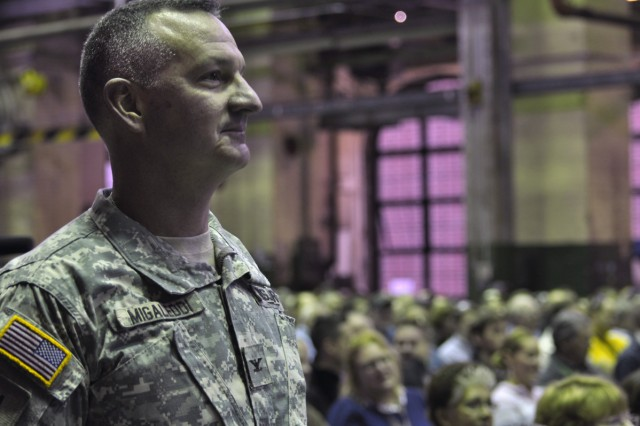 Arsenal Commander Col. Mark F. Migaleddi listening to one of the speakers.