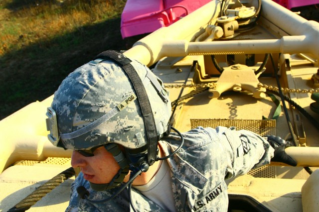 Riding in the back of an M88 recovery vehicle, mechanic Spc. Joseph Lebel monitors towing operations Oct. 2 on West Range at Fort Sill. Lebel is with the 1st Battalion, 17th Field Artillery.