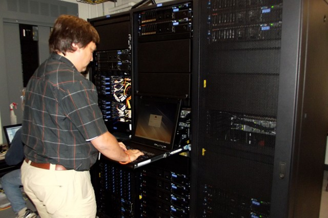U.S. Army Research Laboratory's technicians at Department of Defense Supercomputing Resource Center at Aberdeen Proving Ground, Md., configure the first of two new IBM iDataplex systems that are part of the 2012 High Performance Computing Modernization Program Technology Insertion.
