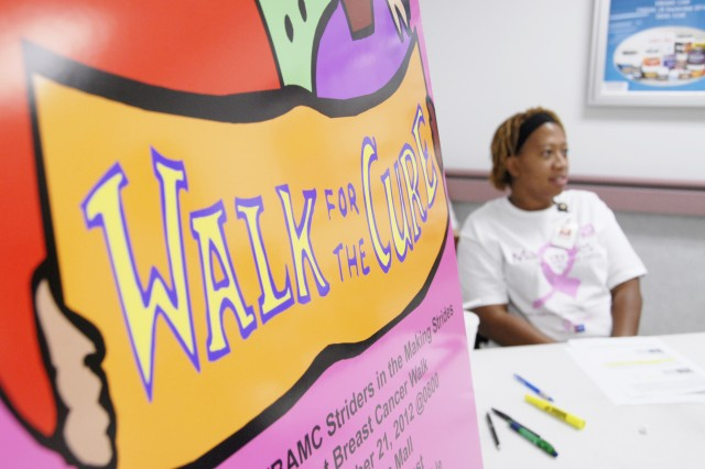 Danielle Threats, a licensed practical nurse at William Beaumont Army Medical Center, mans a sign-up booth Sept. 24 for the Beaumont Striders, volunteers who will participate in the Oct. 21 5k walk at Cielo Vista Mall to raise funds for the American Cancer Society.
