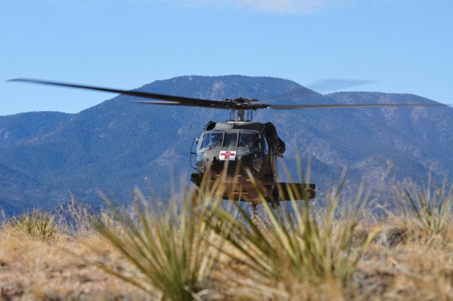 A UH-60 Black Hawk medevac helicopter with Task Force Eagle Assault, 101st Combat Aviation Brigade, 101st Airborne Division, lifts front wheels off the ground during a rolling takeoff on a confined hilltop at Fort Carson, Colo. during Task Force Eagle Assault's rotation to high altitude mountainous environment training, Feb. 20, 2012.