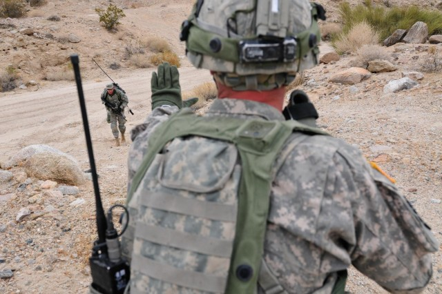 A soldier with the Pathfinder Company, Task Force Saber, 101st Combat Aviation Brigade, 101st Airborne Division tells another soldier to halt his advance during a personnel recovery exercise at TF Sabre's February rotation to the National Training Center at Fort Irwin, Calif.