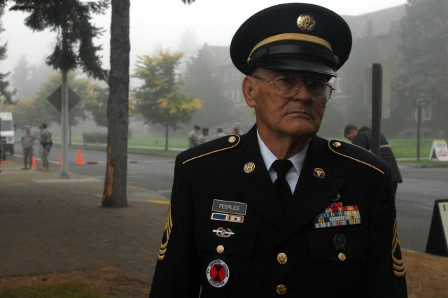 Retired Master Sgt. Gene Peeples, of Largo, Fla., poses for a photo before the reactivation ceremony of the 7th Infantry Division Oct. 10, 2012, at Watkins Parade Field, Joint Base Lewis-McChord, Wash. Peeples, who is the president of the 7th Infantry Division Association, served as combat medic with the 7th Medical Battalion, 7th Inf. Div., from 1952 to 1953 and, again, from 1956 to 1957. He served in the Korean War, and helped the medical battalion establish a hospital at Camp Casey, Korea. This is the second time Peeples has seen the division reactivate; the first reactivation ceremony he attended was at Fort Carson, Colo., in 1999.