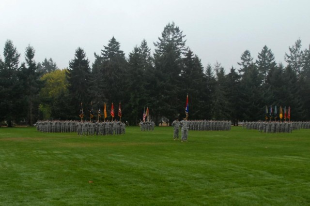 Soldiers from the 2nd Stryker Brigade Combat Team, 2nd Infantry Division; 3rd SBCT, 2nd Inf. Div.; 4th SBCT, 2nd Inf. Div., and the 16th Combat Aviation Brigade stand in formation on Watkins Parade Field, Oct. 10, 2012, in anticipation of the 7th Infantry Division reactivation ceremony. All of the brigades, as well as the 17th Fires Brigade (not pictured) will now fall under control of 7th Inf. Div., following the April announcement by Secretary of the Army John McHugh, for the establishment of a two-star division at Joint Base Lewis-McChord, Wash.