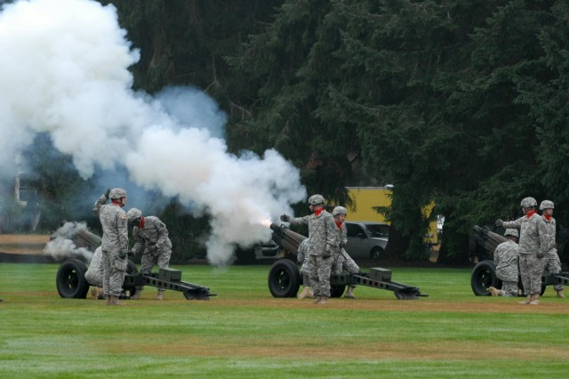 Soldiers with 1st Battalion, 94th Field Artillery Regiment, 17th Fires Brigade, fire their Howitzers during the reactivation ceremony for the 7th Infantry Division, Oct. 10, 2012, at Joint Base Lewis-McChord, Wash. The battalion was the ceremony's official firing battery. The 17th Fires Brigade is one of the 7th Infantry Division's five subordinate brigades.