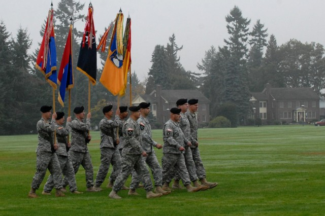 "Soldiers carry the unit colors of (from left to right) 2nd Stryker Brigade Combat Team, 2nd Infantry Division; 3rd SBCT, 2nd Inf. Div.; 4th SBCT, 2nd Inf. Div.; 16th Combat Aviation Brigade; and 17th Fires Brigade, during the reactivation ceremony of the 7th Infantry Division ""Bayonets,"" Oct. 10, 2012, at Joint Base Lewis-McChord, Wash. The 7th Inf. Div. will now be the higher headquarters for each of these brigades, which total nearly 18,000 Soldiers."
