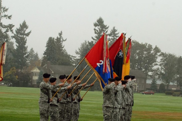 "Soldiers ""present arms"" with the unit colors of, from left to right, 2nd Stryker Brigade Combat Team, 2nd Infantry Division; 3rd SBCT, 2nd Inf. Div.; 4th SBCT, 2nd Inf. Div.; 16th Combat Aviation Brigade; and 17th Fires Brigade, during the reactivation ceremony of the 7th Infantry Division ""Bayonets,"" Oct. 10, 2012, at Joint Base Lewis-McChord, Wash. The 7th Inf. Div. will now be the higher headquarters for each of these brigades, which total nearly 18,000 Soldiers."