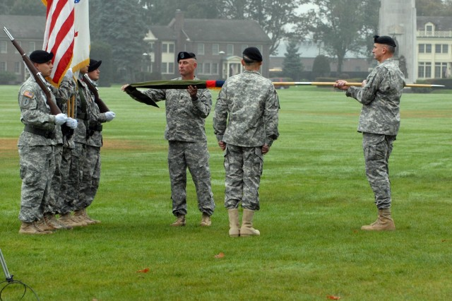 I Corps Commanding General, Lt. Gen. Robert Brown (right) holds the 7th Infantry Division colors, as Command Sgt. Maj. Delbert D. Byers, left, prepares to uncase them with Maj. Gen. Stephen R. Lanza, Oct. 10, 2012, during the 7th Infantry Division reactivation ceremony at Watkins Parade Field, Joint Base Lewis-McChord,Wash. Lanza and Byers will lead the division and its five subordinate brigades, which consist of nearly 18,000 soldiers. The brigades are as follows: 2nd Stryker Brigade Combat Team, 2nd Infantry Division; 3rd SBCT, 2ID; 4th SBCT, 2ID; 16th Combat Aviation Brigade; and 17th Fires Brigade.