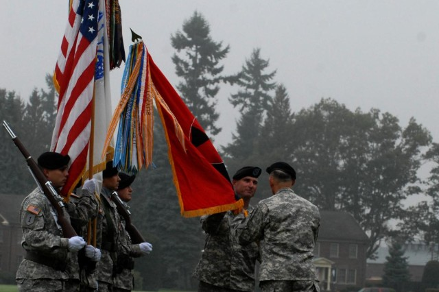 Command Sgt. Maj. Delbert D. Byers, left, accepts the colors from Maj. Gen. Stephen R. Lanza, Oct. 10, 2012, during the 7th Infantry Division reactivation ceremony at Watkins Parade Field, Joint Base Lewis-McChord, Wash. Lanza and Byers will lead the division and its five subordinate brigades, which consist of nearly 18,000 soldiers. The brigades are as follows: 2nd Stryker Brigade Combat Team, 2nd Infantry Division; 3rd SBCT, 2ID; 4th SBCT, 2ID; 16th Combat Aviation Brigade; and 17th Fires Brigade.