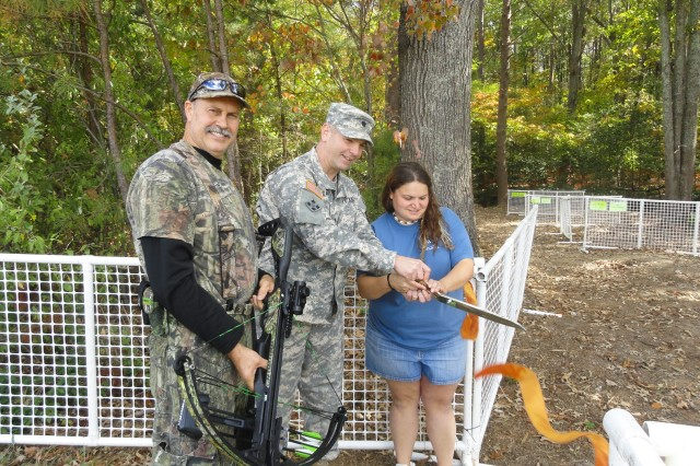 Mr. Ralph Iglesias, Lt. Col. Peter E. Dargle, Fort A.P. Hill garrison commander, and Game Check Station Manager Marsha Randolph, cut the ribbon October 10th to open FMWR's latest recreation area for Fort A.P. Hill. The archery range is located directly behind the Game Check Station on Fort A.P. Hill Drive.