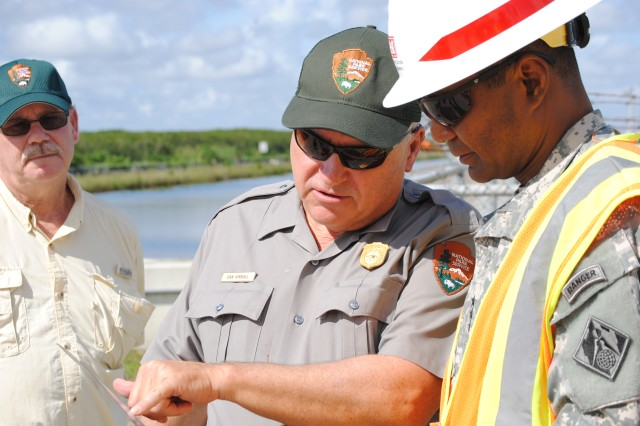 Dave Sikkema (left),project manager for Everglades National Park and  Dan Kimball (center), superintendant of Everglades National Park,  provide Lt. Gen. Thomas P. Bostick, commanding general of the U.S. Army Corps of Engineers (right), with an overview of the benefits of the Tamiami Trial Bridge Modifications project Oct. 10, 2012.