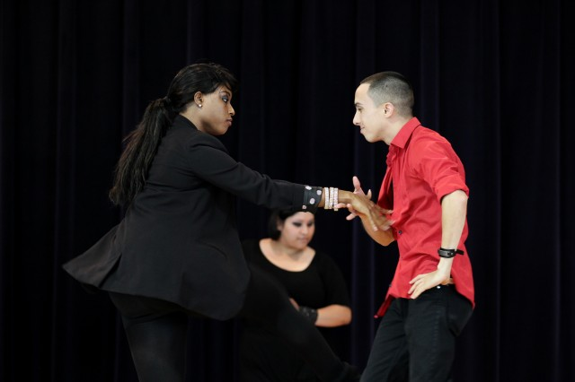 Navy Yeoman 3rd Class Irving Figueroa, Navy Information Operations Command Maryland, and Terrisa Widener, a logistics management specialist at the Pentagon, perform the Bachata, a slow dance from the Dominican Republic, during the installation's annual Hispanic Heritage Month Observance. (Photo by Jen Rynda)