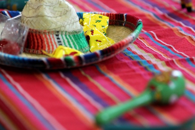 Mexican sombreros and candy and South American maracas are displayed at the Hispanic Heritage Month Observance. (Photo by Jen Rynda)