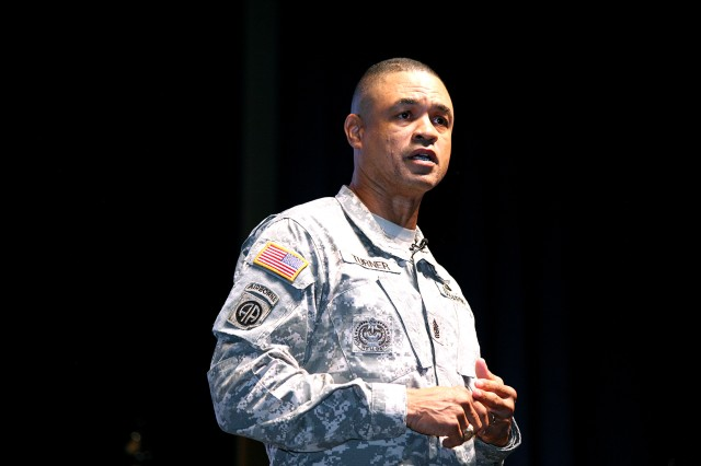 Command Sgt. Maj. Larry S. Turner, U.S. Army Space and Missile Defense Command/Army Forces Strategic Command command sergeant major, updates the command's Redstone Arsenal workforce during a town hall at Von Braun III auditorium Oct. 9.