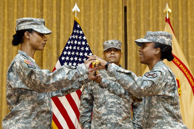 Incoming Joint Base Myer-Henderson Hall Command Sgt. Maj. Earlene Y. Lavender (left) receives the NCO Sword from Col. Fern O. Sumpter (right), JBM-HH commander, during the assumption of responsibility ceremony at Spates Community Club, Oct. 4. Photo By Rachel Larue.