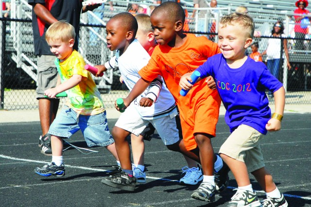 Track athletes leave the starting line of the 4 X 100-meter relay race during the 2012 Child, Youth and School Services Pre-K Olympics Friday at Pullen Track, Fort Belvoir.