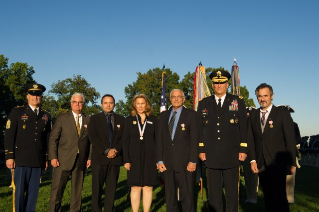 From left, Sgt. Maj. of the Army Raymond F. Chandler III, Mike Conklin, Steve Dunning, Bonnie Carroll, Dr. Edmund Tramont, U.S. Army Chief of Staff Gen. Raymond T. Odierno and David Feherty pose for a group photo after the Outstanding Civilian Service Award presentation during the Twilight Tattoo ceremony at Joint Base Myer-Henderson Hall, Va. Oct. 11, 2012.