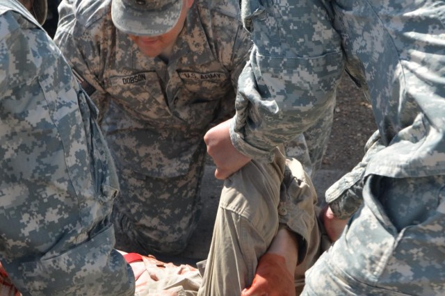 A wounded Soldier is picked up by three first responders during a mass casualty, or mascal, drill at Fort Polk, La., Oct. 8, 2012. Task Force Wings participates in a mascal, to ensure that units are ready in case they ever encounter the real thing.