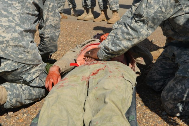 A first responder applies pressure to a notional casualty's wound during a mass casualty, or mascal, drill at Fort Polk, La., Oct 8, 2012. Task Force Wings participates in a mascal, to ensure that units are ready in case they ever encounter the real thing.