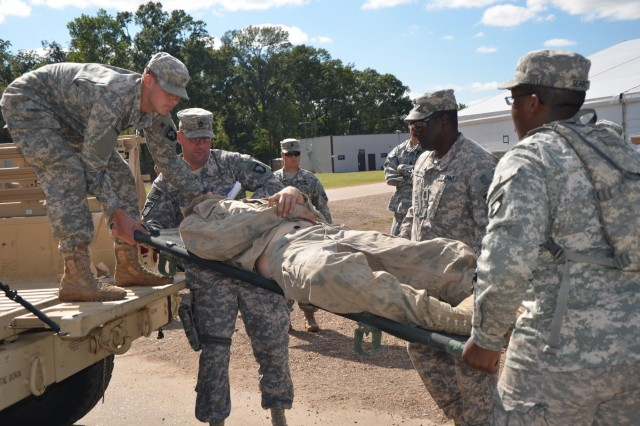 Litter carriers from Task Force Wings, load a patient onto a Humvee for transport to the combat hospital. Task Force Wings participated in a mass  casualty drill to ensure that the Soldiers are ready in case they ever encounter the real thing.