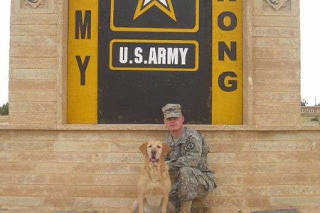 Retired Sgt. 1st Class Gabe and his handler-cum-owner now-Sgt. 1st Class Charles Shuck pose between explosives detection missions in Iraq. Gabe was recently named the American Humane Association's 2012 Hero Dog of the Year.