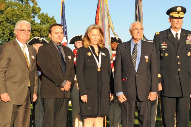 Five civilians were honored by the Army chief of staff for their outstanding and exceptional service to Soldiers and their families at a special twilight tattoo Oct. 11, 2012, at Joint Base Myer-Henderson Hall. From left to right: Sgt. Maj. of the Army Raymond F. Chandler III, Mike Conklin, Steve Dunning, Bonnie Carroll, Dr. Edmund C. Tramont, Army Chief of Staff Gen. Ray Odierno and David Feherty.