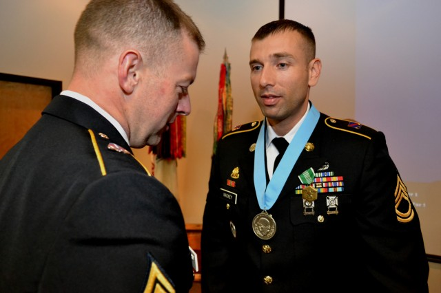 Command Sgt. Maj. James Wills, senior enlisted leader, 80th Training Command (TASS), congratulates Sgt. 1st Class Mark Mackey, platoon sergeant A Company 3/379th Battalion following Mackey's induction into the Sergeant Audie Murphy Club during the USARC SAMC induction ceremony hosted by the 80th Training Command (TASS) at Marshall Hall, Fort Knox Ky. Oct. 11, 2012.