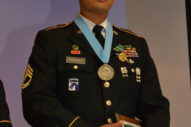 Sgt. 1st Class Martin Rodriguez, acting first sergeant of the 1/104th Military Police Company, following his induction into the United States Army Reserve Command's chapter of the Sergeant Audie Murphy Club during a ceremony hosted by the 80th Training Command (TASS) at Marshall Hall, Fort Knox Ky. Oct. 11, 2012. Rodriguez received the club's lifetime membership card, a certificate of achievement from the USARC command sergeant major, the Audie Murphy Medallion and the Army Commendation medal.