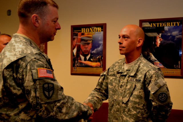 Command Sgt. Major James Wills, senior enlisted leader of the 80th Training Command, congratulates Sgt. 1st Class Michael Pike, an instructor with the 1st Battalion, 31st Regiment, 102nd Division, for winning the 80th Training Command Instructor of the Year competition in the enlisted category at Fort Knox, Ky., Oct. 13, 2012.