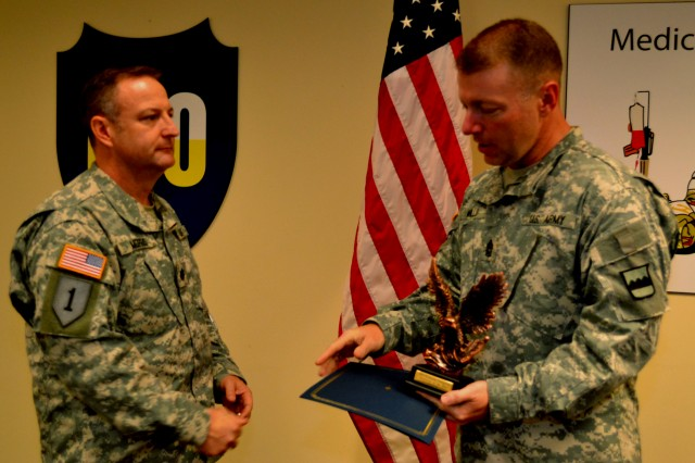 Lt. Col. Michael Morris, an instructor with the 10th Battalion, 80th Regiment, stands ready to accept the the 80th Training Command Instructor of the Year award in the officer category from Command Sgt. Major James Wills, the command's senior enlisted leader, at Fort Knox, Ky., Oct. 13, 2012.