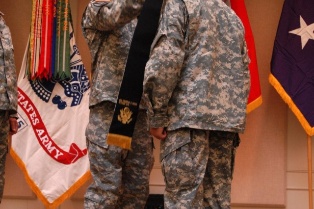 Maj. Gen. Stephen R. Lanza (left), commanding general of 7th Infantry Division, places the stole on Lt. Col. Darryl Hollowell, chaplain, during the 7th Inf. Div. Assumption of Stole ceremony, Oct. 12, at the Four Chaplains Memorial Chapel. The Stole Ceremony is among the oldest known rituals. Clergy wear stoles as symbols of their spiritual leadership responsibility. Specifically, the stole reminds us of a chaplain's role as a spiritual-leader, servant-leader, and as God's representative among the people.
