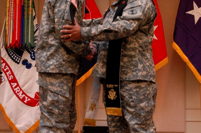 Lt. Col. Darryl Hollowell (right), 7th Infantry Division chaplain, shakes the hand of the 7th Inf. Div. commanding general, Maj. Gen. Stephen R. Lanza, Oct. 12, during Hollowell's Assumption of Stole ceremony at Joint Base Lewis-McChord, Wash.