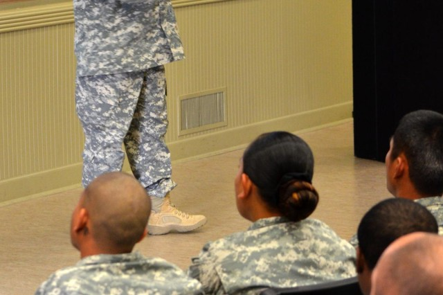 Lt. Col. Darryl Hollowell, 7th Infantry Division chaplain, speaks to 7th Inf. Div. soldiers Sept. 24, at Joint Base Lewis-McChord's French Theater, during suicide prevention and resiliency training.