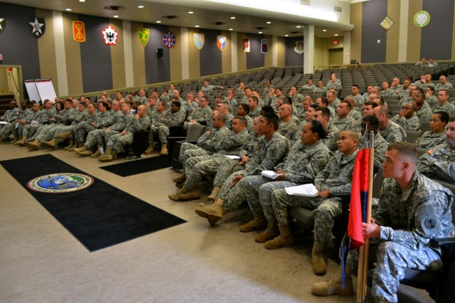 """Soldiers from Headquarters Support Company, 7th Infantry Division, listen to their commanding general, Maj. Gen. Stephen R. Lanza, Sept. 24, at Joint Base Lewis-McChord's French Theater. The company, consisting of about 150 Soldiers, dedicated the entire day to suicide and resiliency training, which included watching the """"Shoulder-to-Shoulder"""" video and participating in interactive group discussions with the JBLM Suicide Prevention Officer and Master Resiliency Trainers in the unit."""