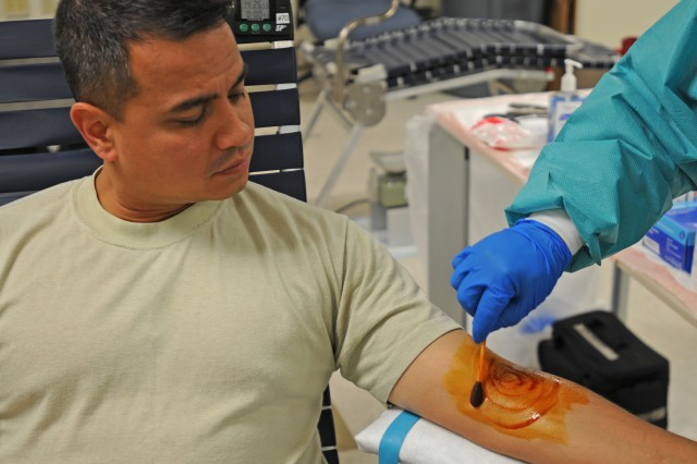 "FORT BLISS, Texas "" Cpt. Jessie Iglesias, officer in charge of the 15th Sustainment Brigade's supply shop, gets his skin sanitized with Iodine in preparation for a blood donation Oct. 2, 2012. The 15th SB hosted the Armed Services blood drive with help from William Beaumont Army Medical Center at its brigade headquarters on Fort Bliss, TX to help increase the emergency blood supply used for Servicemembers in need.  To continue these life-saving measures the 15th SB is scheduled to conduct additional   blood drives on Oct. 15 and 16 at its brigade headquarters. (U.S. Army photo by Sgt. Robert Golden, 16th Mobile Public Affairs Detachment)"