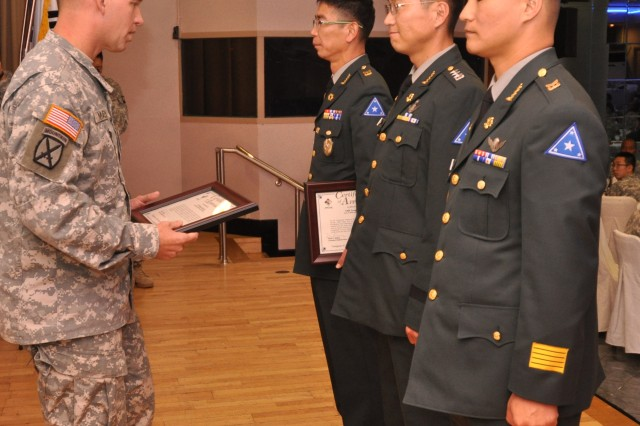 Col. Michael E. Masley, garrison commander of USAG Yongsan, presented certificates of appreciation from left to right to Command Sgt. Major. Yang, Hoy Jung, of Area II ROKA support group, Capt. Jang, Deok Jin, ROKA Staff Officer for Headquarters and Headquarters Company, and Sgt. Maj. Kim, Dae Hyun, ROKA Staff Sgt. Maj. for 142nd Military Police Company during ROK Armed Forces Day Commemorative Luncheon and Best Friends Award Ceremony, Oct. 12. (U.S. Army photo by Sgt. Kevin Frazier)