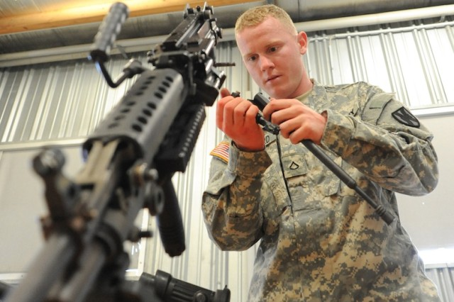 Pfc. Richard Shepard, 21st Theater Sustainment Command, attempts to correctly assemble four weapons at the weapons assembly lane during the  Best Warrior Competition in Grafenwoehr, Germany, Aug. 1, 2012.  Shepard is the U.S. Army Europe representative.